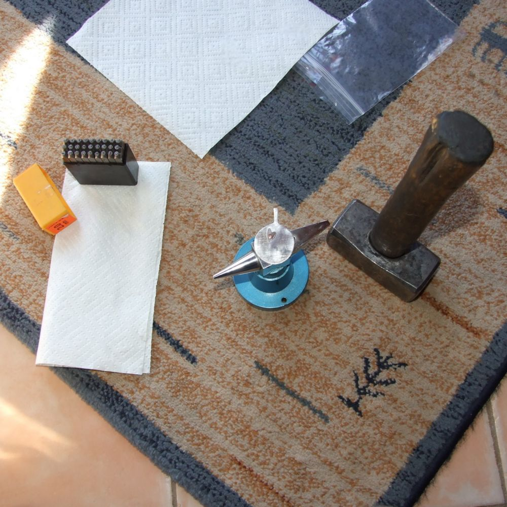 Set up for letter stamping on sterling silver pendant