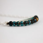 Horizontal silver bar necklace with Czech glass bead pendant
