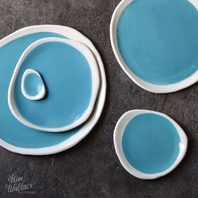 Handmade ceramic plates in aqua