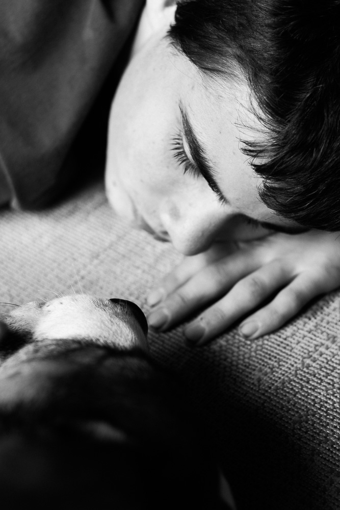 boy and his dog laying on the mat in companionable silence